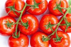De rijpe tomaten met water laat vallen 3 Stock Afbeelding