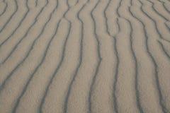 De rimpelingen van het zand Stock Afbeeldingen