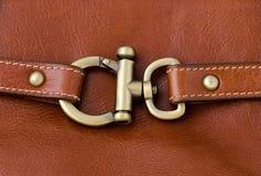 De ring van het slotmetaal op Bruin Leer royalty-vrije stock afbeeldingen