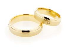 De ringen van de gouden bruiloft op wit Royalty-vrije Stock Foto