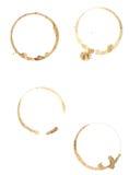 De ringen van de koffie op zuiver Witboek. Stock Afbeelding