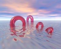 De Ringen van het leven op Oceaan Stock Foto's
