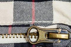 De ritssluiting een detail van jeans sluit omhoog Stock Foto
