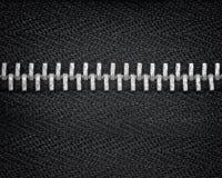 De ritssluitingstanden sluiten omhoog met zwarte stof Stock Afbeeldingen