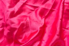 De rode achtergrond van de stoffentextuur of rode stoffenachtergrond Royalty-vrije Stock Afbeeldingen