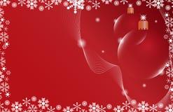 De rode bal van Kerstmis twee op een rode achtergrond Royalty-vrije Stock Afbeeldingen