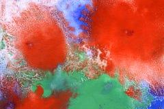De rode blauwe vlek spreidt uit stock foto