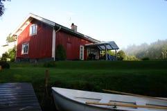 De rode cabine Stock Foto's