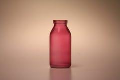 De rode Fles van het Water Stock Foto
