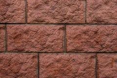 De rode geweven achtergrond van de baksteen rustieke muur met een cement in naden Stock Afbeelding