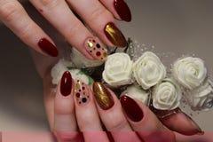 De Rode glamour van het manicureontwerp Stock Afbeelding