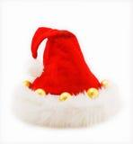 De rode hoed van Kerstmis met ballen op wit Royalty-vrije Stock Afbeeldingen