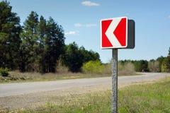 De rode indicator van de wegdraai stock afbeeldingen