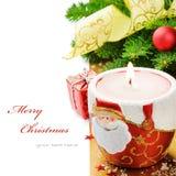 De rode kaars van Kerstmis op feestelijke achtergrond Stock Foto's