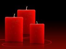 De rode Kaarsen van Kerstmis Stock Afbeeldingen