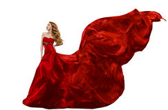 De Rode Kleding van de vrouwenmanier, Toga die op Wind, Vliegende Zijdestof golven stock afbeelding