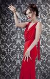 De rode kleding van het meisje met mes Stock Afbeeldingen