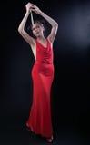 De rode kleding van het meisje met mes Stock Afbeelding