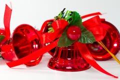 De rode klokken van Kerstmis Stock Afbeeldingen