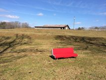 De rode laag die ontspanning toelaten vanaf is schuur Royalty-vrije Stock Afbeelding