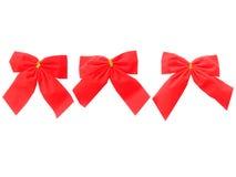 De rode linten van Kerstmis verschillend in de grootte Stock Foto's
