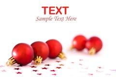 De rode snuisterijen van Kerstmis Stock Foto's
