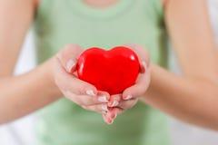 De rode Steun van de de Gezondheidsliefde van de Hartvorm Stock Fotografie