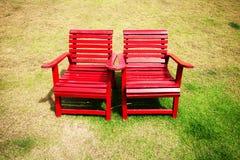 De Rode Stoelen van het duo Stock Afbeelding