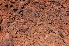 De rode textuur van de Strandmuur, Santorini Stock Foto