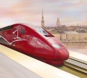 De rode trein van de hoge snelheid Stock Foto's
