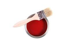 De rode verf kan met borstel royalty-vrije stock afbeeldingen