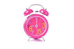 De rode wekker toont 11 uur Stock Afbeelding