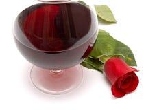 De rode wijn en rood nam toe stock fotografie