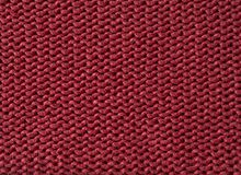 De rode wol gebreide abstracte achtergrond van de stoffentextuur Stock Foto's
