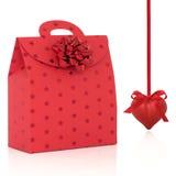 De rode Zak van de Gift en Hart Gevormde Snuisterij Stock Foto