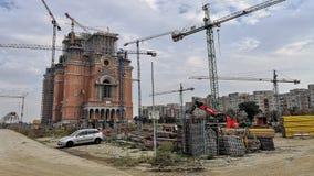 De Roemeense Kathedraal van de Mensen` s in aanbouw Redding stock afbeeldingen