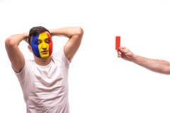 De Roemeense voetbalventilator van het nationale team van Roemenië krijgt rode kaart Royalty-vrije Stock Afbeelding