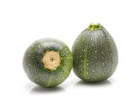 De ronde courgettes Cucurbita pepoisolated op witte achtergrond Stock Afbeelding