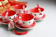 De rood de nieuwe kom, eetstokjes en China wensen ja dit Royalty-vrije Stock Foto's