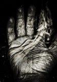 De rook van de handen versleten tegen tijd stock foto's