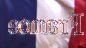 De roterende titel van glasfrankrijk tegen golvende Franse vlag stock video