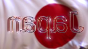 De roterende titel van glasjapan tegen golvende Japanse vlag stock video