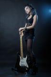 De rots van de vrouw met gitaar Stock Fotografie