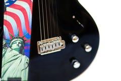 De Rotsen van Amerika - gitaar en Standbeeld van Vrijheid Royalty-vrije Stock Foto's