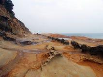 De rotsen van de kust Stock Afbeeldingen