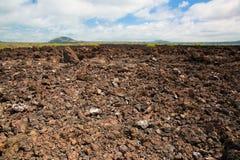 De rotsen van het basalt. Het Westen van Tsavo, Kenia, Afrika stock afbeeldingen
