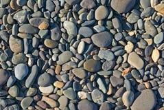 De rotsen van het strand Stock Afbeelding