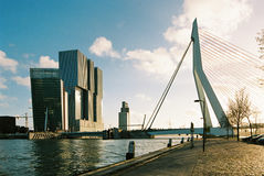 De Rotterdam & Erasmus. The De Rotterdam building in Rotterdam, the Netherlands by architects OMA and the Erasmus Bridge Stock Image