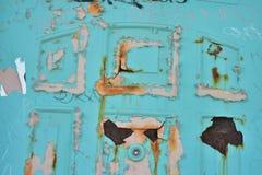 De roze en turkooise achtergrond van de de deurtextuur van de schilverf Stock Afbeeldingen