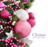 De roze en zilveren grens van Kerstmisornamenten Stock Foto